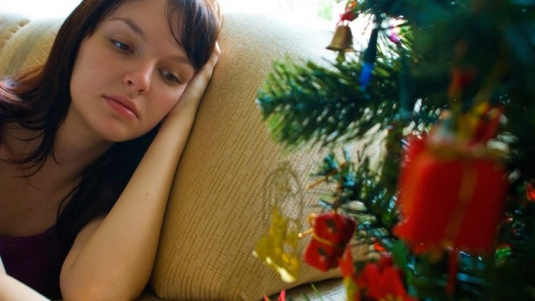 Woman feeling lonely at Christmas.