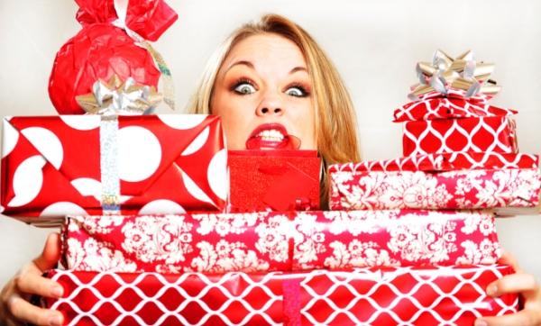 Beautiful stressed young woman with gifts