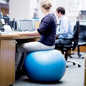 Sitting on an exercise ball at work.